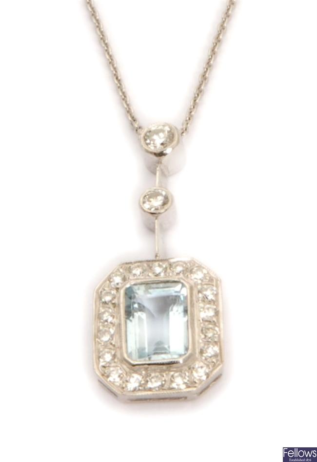 An aquamarine and diamond pendant, comprising two