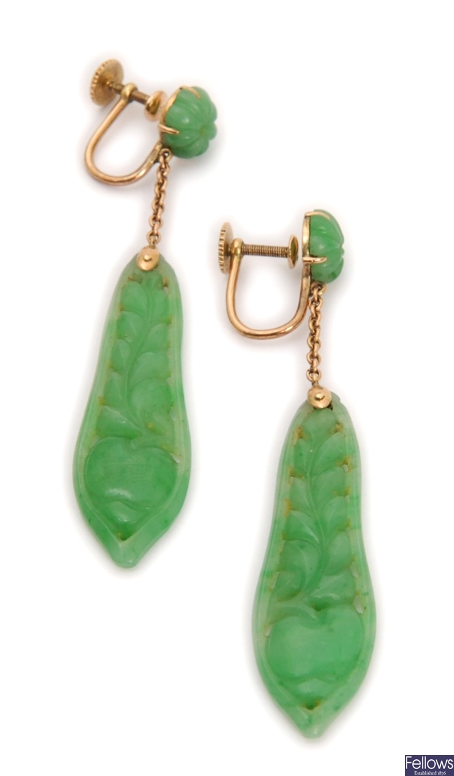 A pair of carved jade dropper earrings, with a