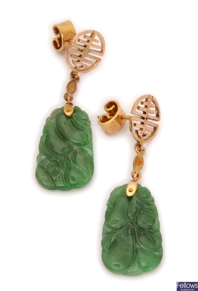 A pair of carved jade dropper earrings, with an