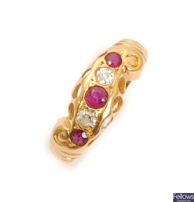 An early 20th century five stone ruby and diamond