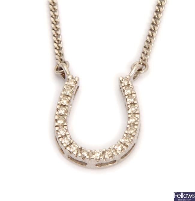 A 9ct white gold diamond set horse shoe design