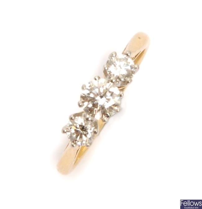 An 18ct three stone round brilliant diamond ring,
