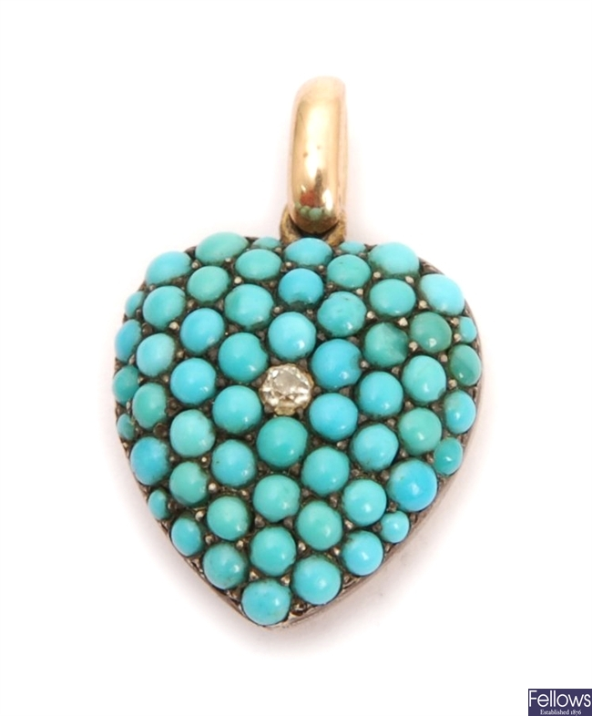 An Edwardian heart shaped pendant set with a