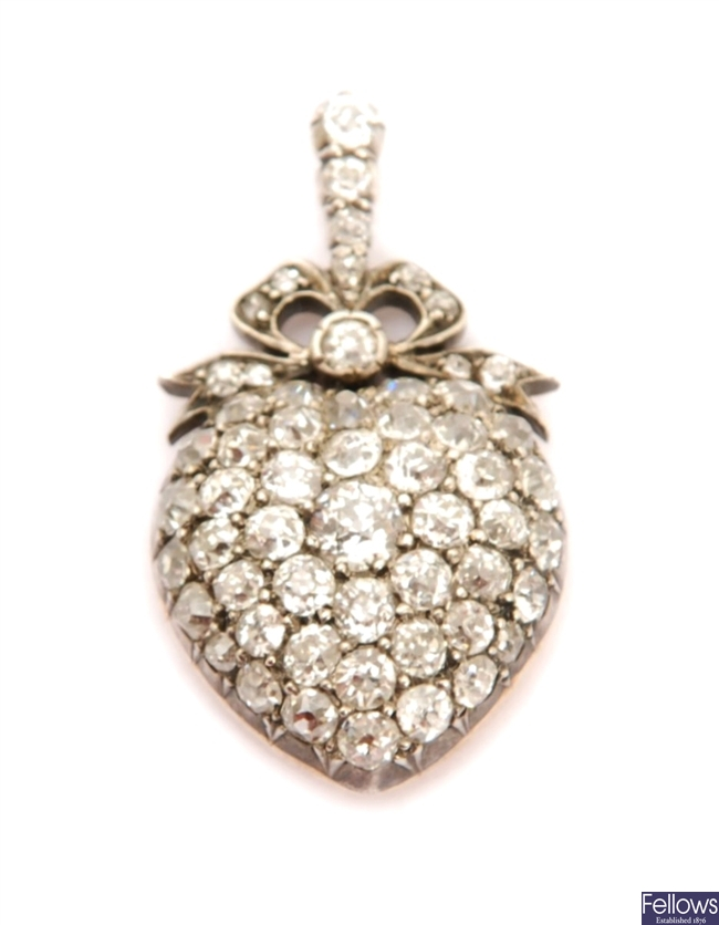 A Victorian heart shaped diamond set pendant with