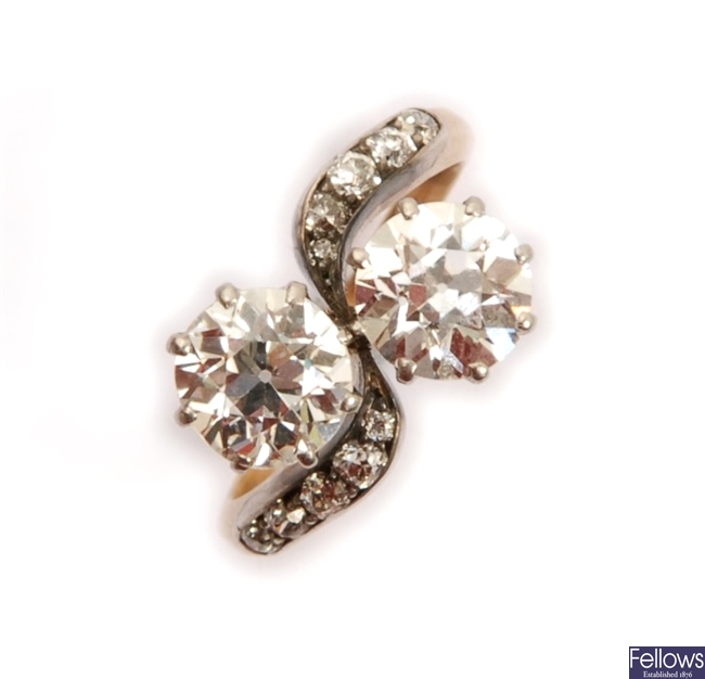 A two stone diamond ring in a crossover design
