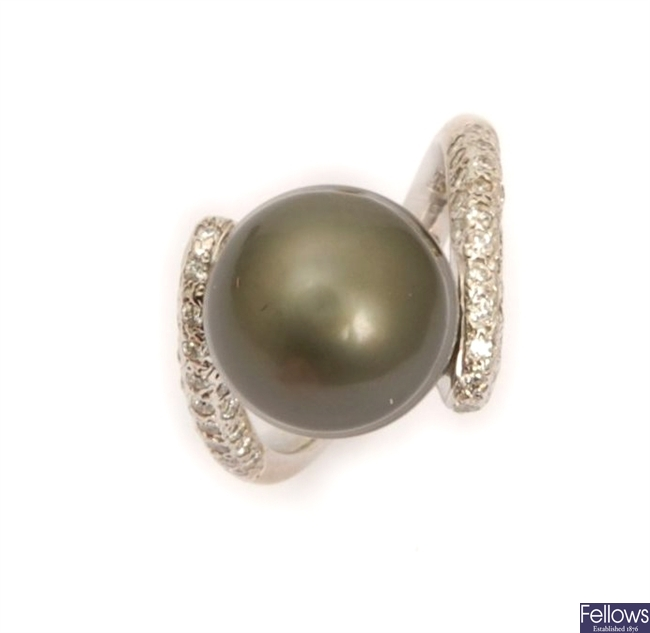 A black cultured pearl and diamond cross over