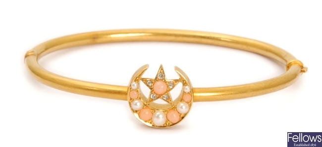 A Victorian crescent design hinged bangle, in a