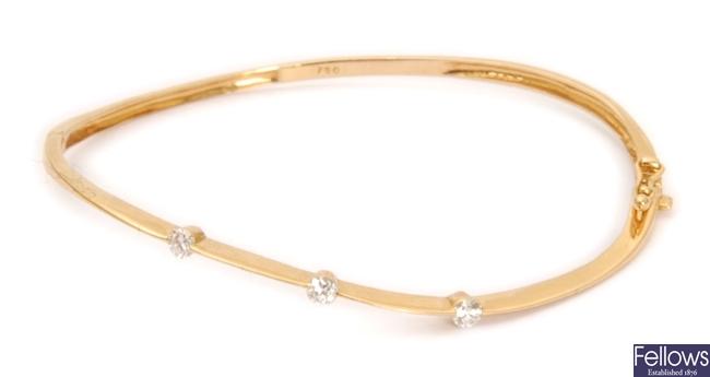 A diamond set hinged bangle, set with three