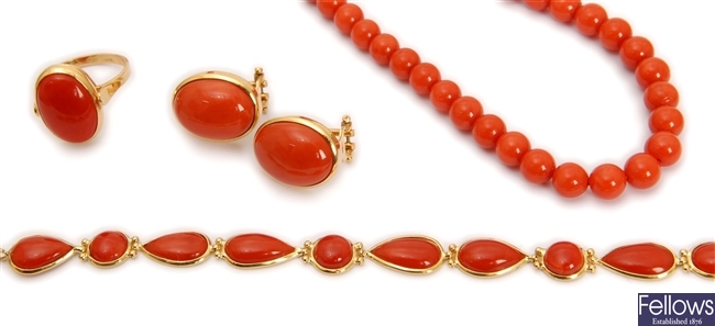 Four items, to include an 18ct gold coral