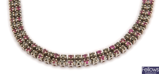 A sapphire and ruby set necklace, in a two row