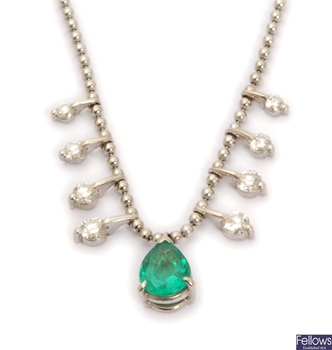 An emerald and diamond necklace, with a central