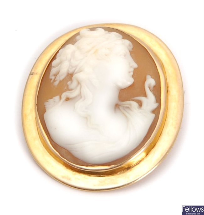 An oval shell cameo brooch depicting diana the