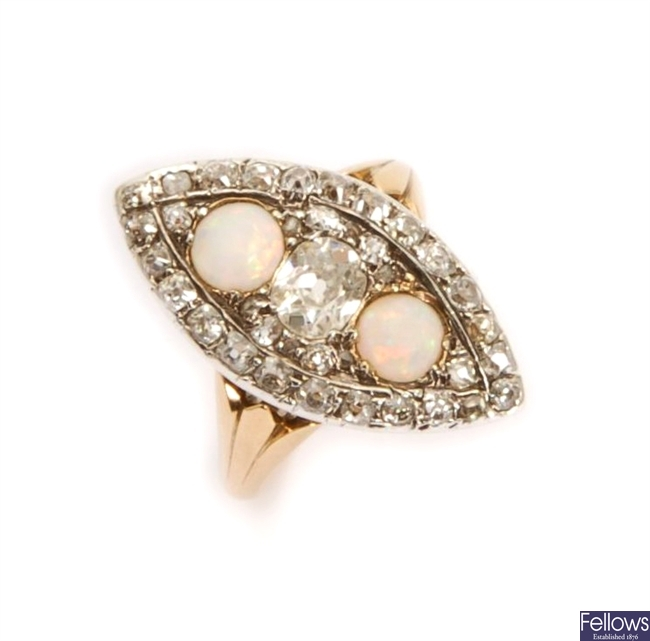 A marquise shape opal and diamond up finger ring,