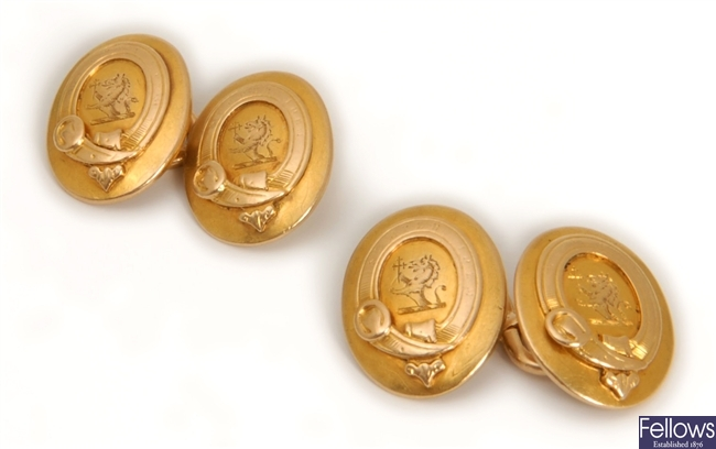 A pair of early 20th century oval cufflinks, each