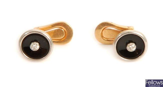 A pair of early 20th century diamond and onyx