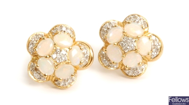 A pair of floral design opal and diamond cluster