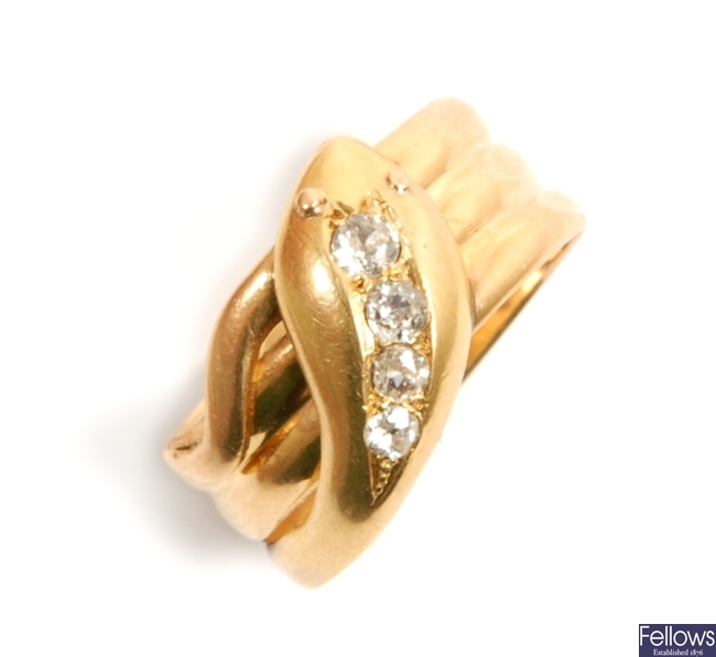 An 18ct gold diamond set snake ring, in a coiled