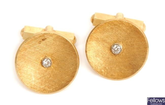 A pair of diamond set circular cuff links, with a