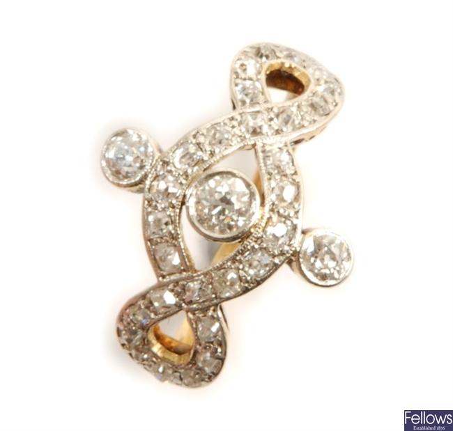A three stone twist design ring, comprising three