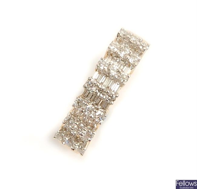 A diamond set band ring, comprising seven raised