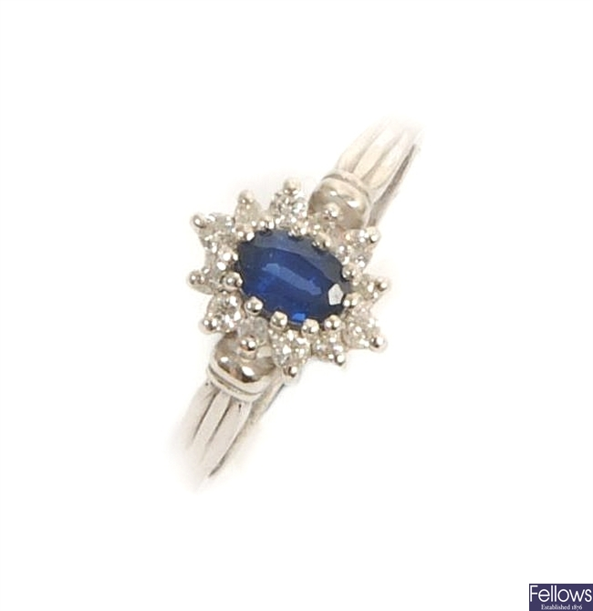 An 18ct white gold sapphire and diamond cluster