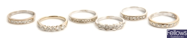 Six white gold diamond set band rings, to include