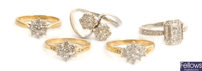 Five 18ct gold diamond set rings, to include a