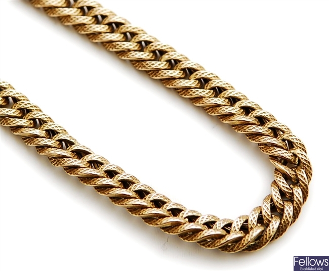 A 9ct gold textured double curb link chain.