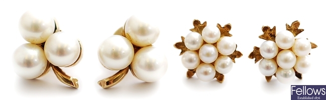Two pairs of cultured pearl cluster earrings,