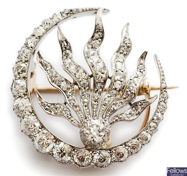 A Victorian diamond set crescent and flame