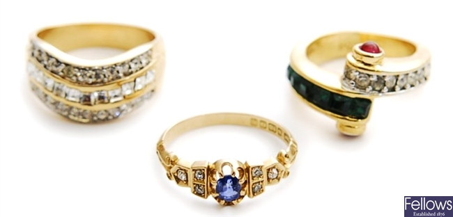Three rings, to include two metal paste set dress