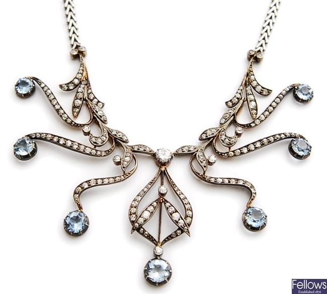 An ornate aquamarine and diamond necklace,