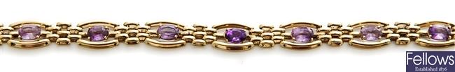 A 9ct gold amethyst set gate bracelet, comprising