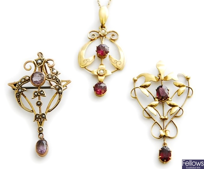 Three early 20th century pendants, to include a