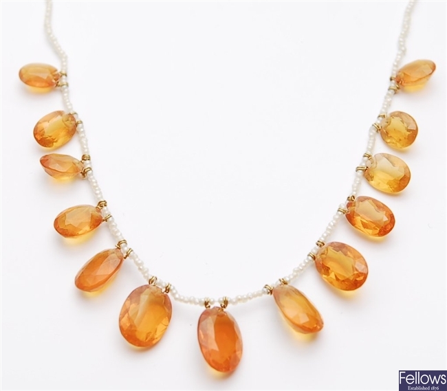 An early 20th century seed pearl and fire opal
