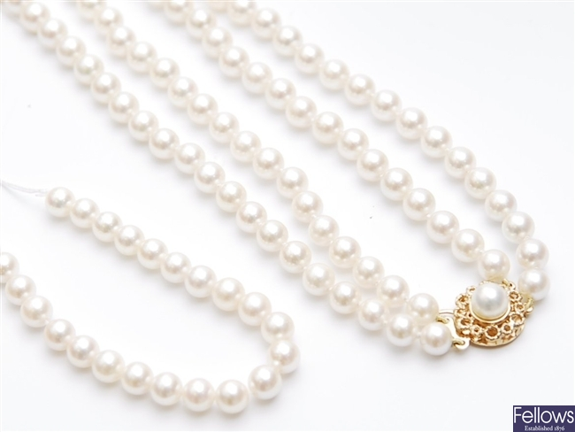 A two row uniform cultured pearl necklace with a