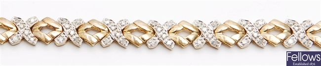 A 9ct gold diamond set cross link design bangle,