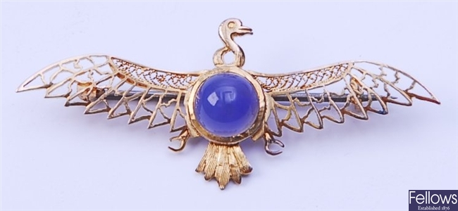 A phoenix brooch, comprising a central round