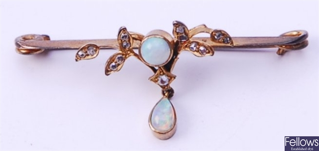 An Edwardian opal and diamond set bar brooch,