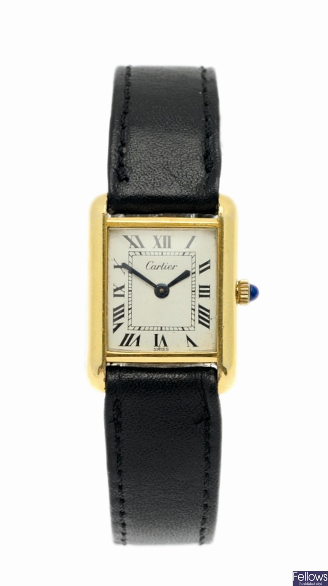 CARTIER - A gold-plated manual wind Tank