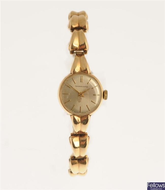 GARRARD - a 9ct gold manual wind lady's wrist