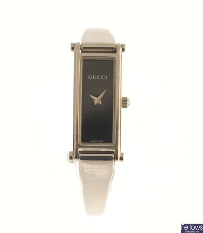 GUCCI - a stainless steel quartz lady's bangle