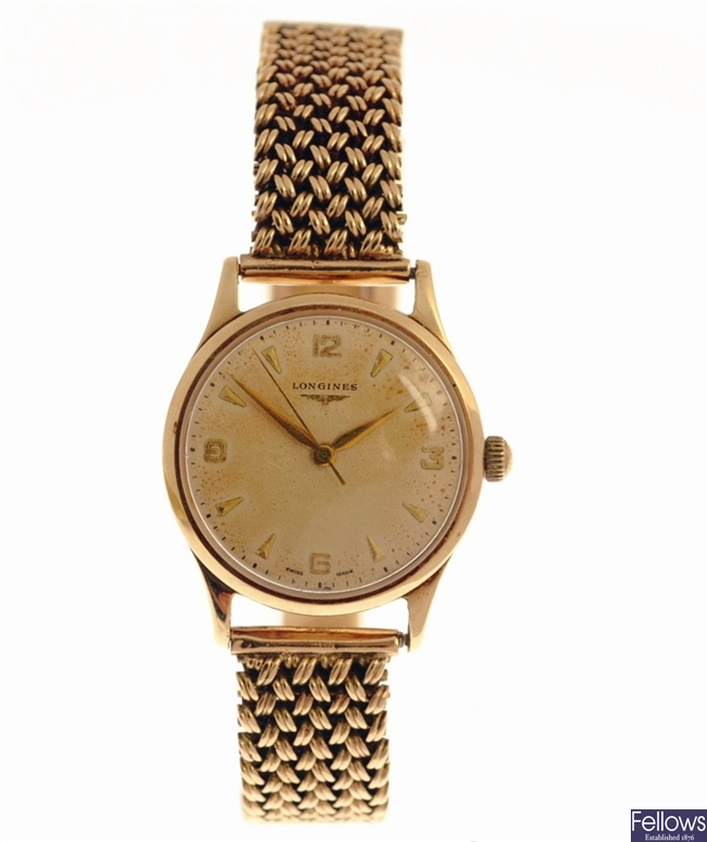 LONGINES - a 9ct gold manual wind gentleman's