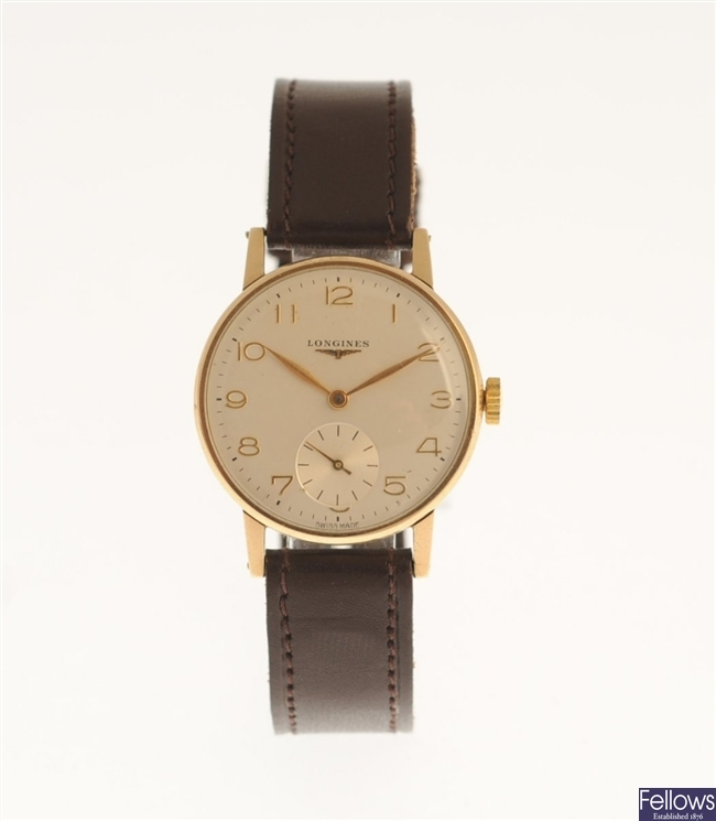 LONGINES - a gentleman's 9ct gold manual wind