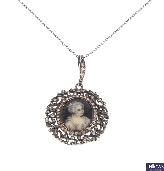 A paste and silver memorial pendant featuring the