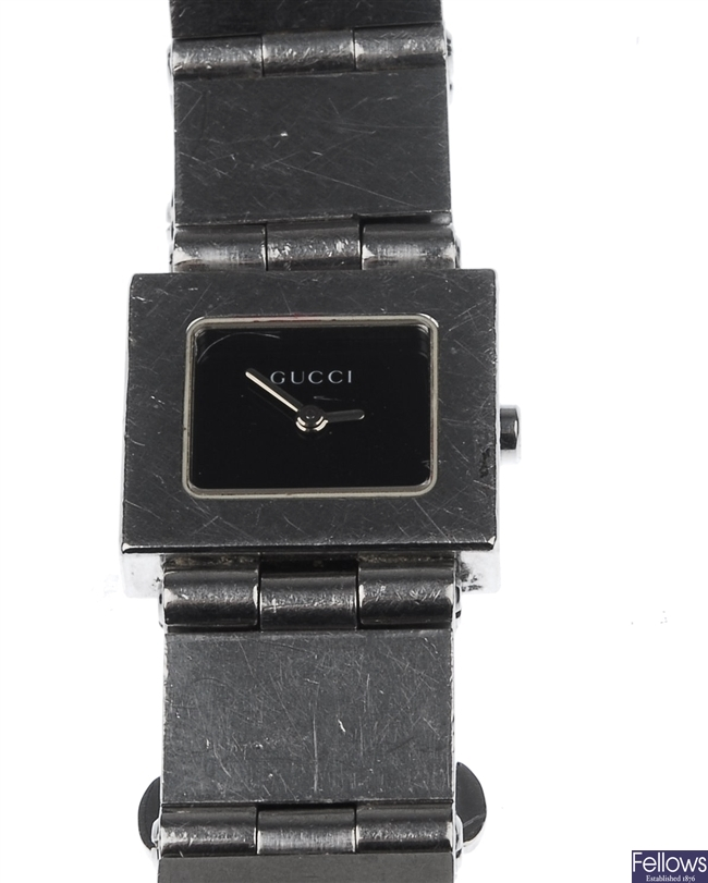 GUCCI - a lady's stainless steel square watch