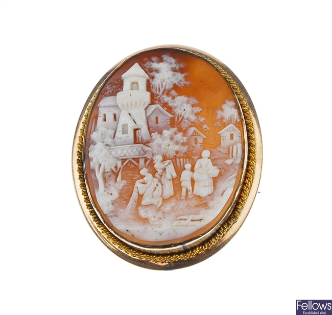 A collection of cameo and wedgewood brooches