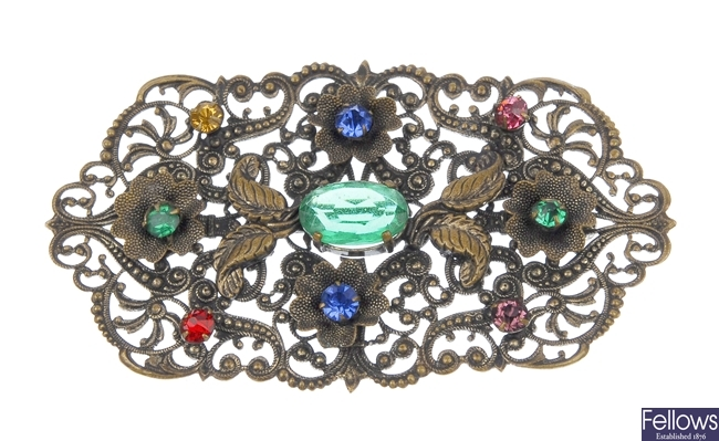 A quantity of twenty-two paste brooches of