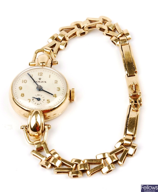 ROLEX - a lady's 9ct gold circular watch with