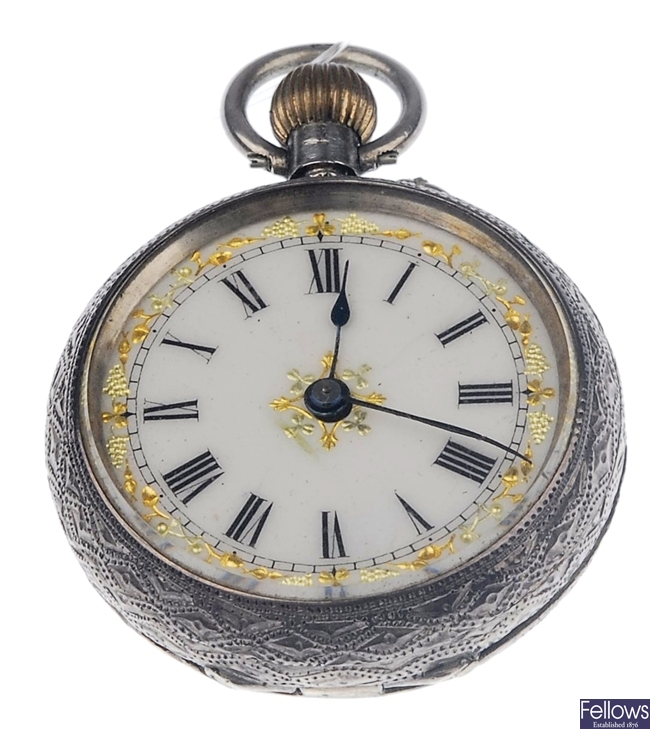 A silver open face, top wind fob watch with cream
